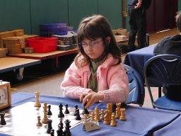 Marie lors de son premier tournoi d'échecs à l'âge de 7 ans